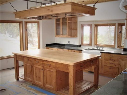 Custom Woodworking in Pagosa Springs, Colorado specializing in custom kitchen cabinets, bathroom vanities, entry doors, interior doors, staricases and custom furniture built to each client's specifications.