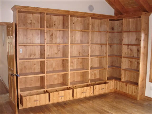 Custom wraparound library with shelving and drawers